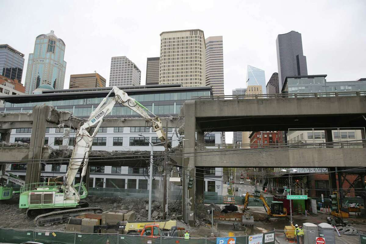 Work continues on dismantling the double decker portion of the Alaskan Way Viaduct near Columbia and Marion Streets, Wednesday, April 10, 2019. (Genna Martin, Seattlepi.com)