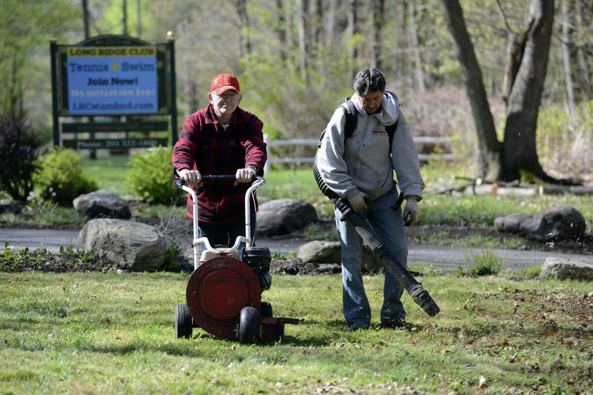 Camilo Eiomez and Fabio Velosquez help with the clean up efforts on April 30, 2016 at the Long Ridge Club in Stamford. The private swim and tennis clubwas preparing for its season opening on Sunday.