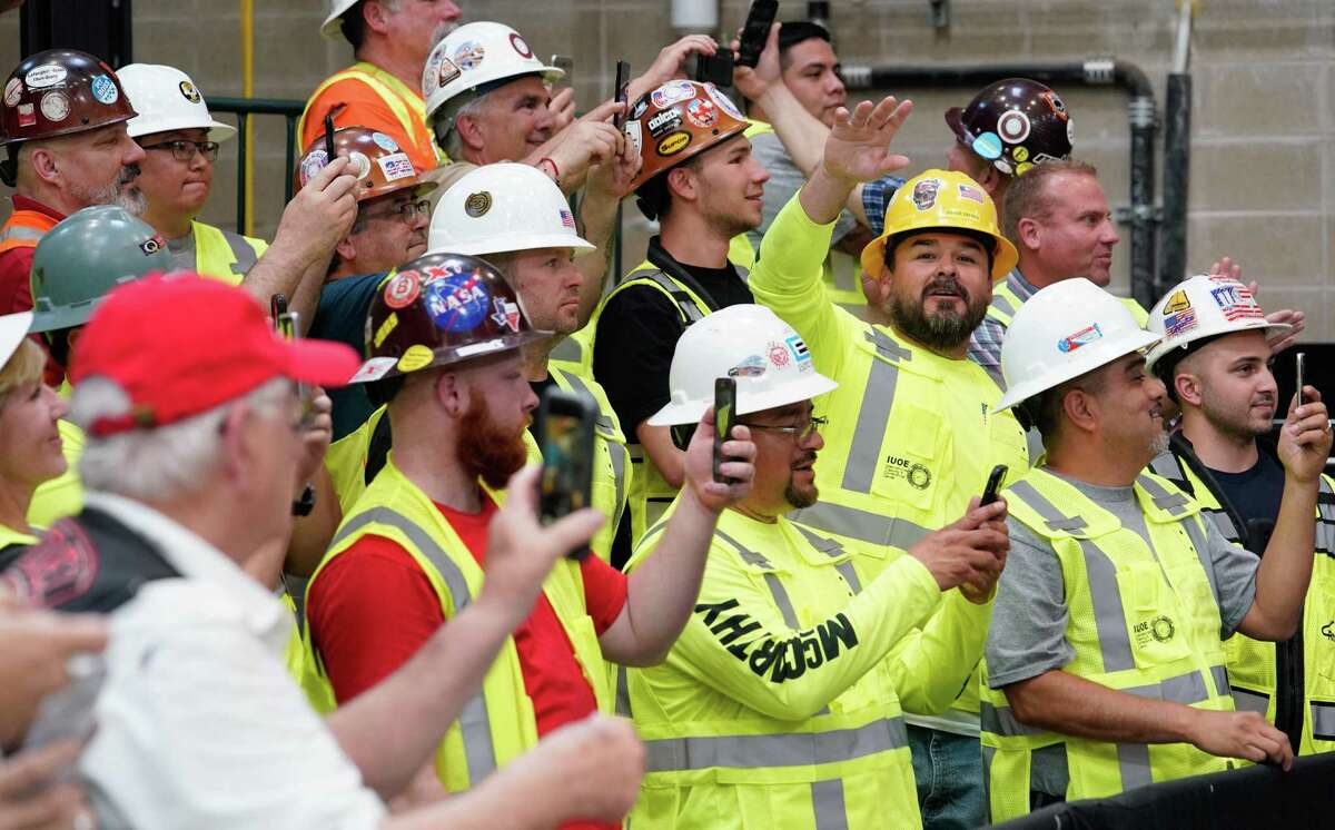 The crowd listens to President Donald Trump at the International Union of Operating Engineers (IUOE) International Training Center, Wednesday, April 10, 2019 in Crosby.