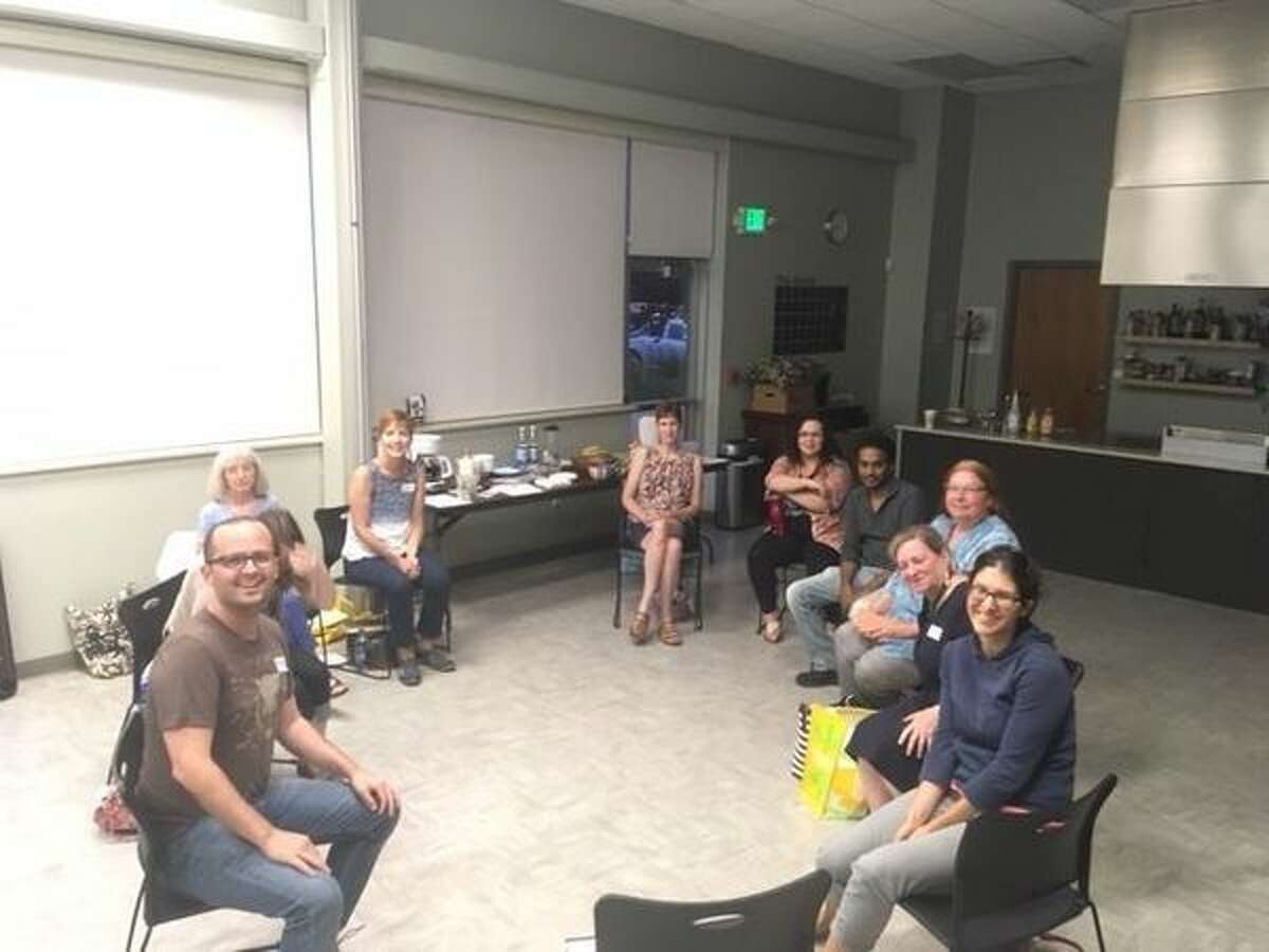 Members from the Albany Food Readers group, a local book club that focuses on food-concentrated reads, during a July 2018 meeting. (Provided)