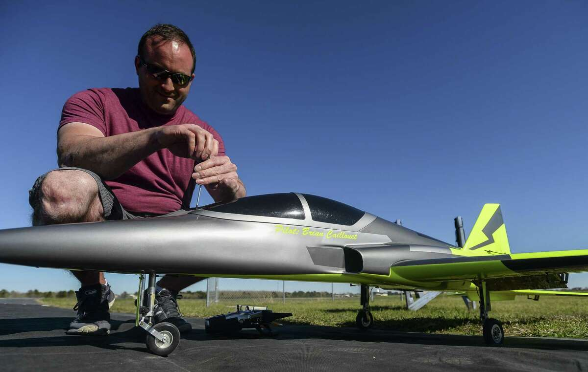 Brian Caillouet screws the cover shut of his radio-controlled jet as he gets it ready for a flight at the Beaumont Radio Control Club Sunday. Photo taken on Sunday, 02/24/19. Ryan Welch/The Enterprise