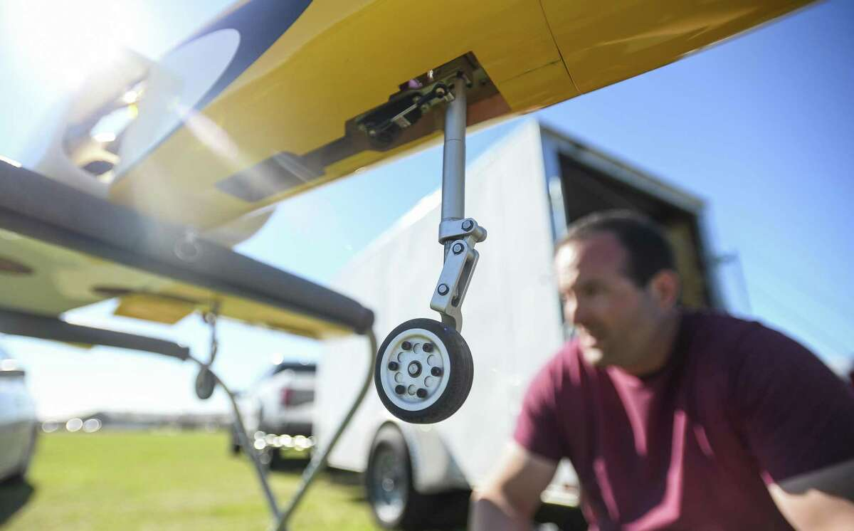 Brian Caillouet inspects the landing gear on one of his radio-controlled jets at the Beaumont Radio Control Club Sunday. Photo taken on Sunday, 02/24/19. Ryan Welch/The Enterprise