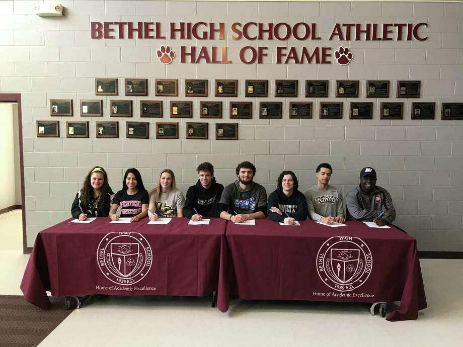 Eight Bethel seniors who will play sports in college were honored last week during a ceremony. From left: Sam Barnum, (lacrosse, Framingham State), Michelle Nunes (field hockey, Western Connecticut), Gabby Kahn (crew, Central Florida) Jonathan Bell (track, Ramapo), Jack Carraturo (baseball, Central Connecticut), Tyler Zegray (basketball, UCONN AP), Chris Towey (basketball, Connecticut College), Couri Baker (football, Western Connecticut). Photo: Contributed Photo