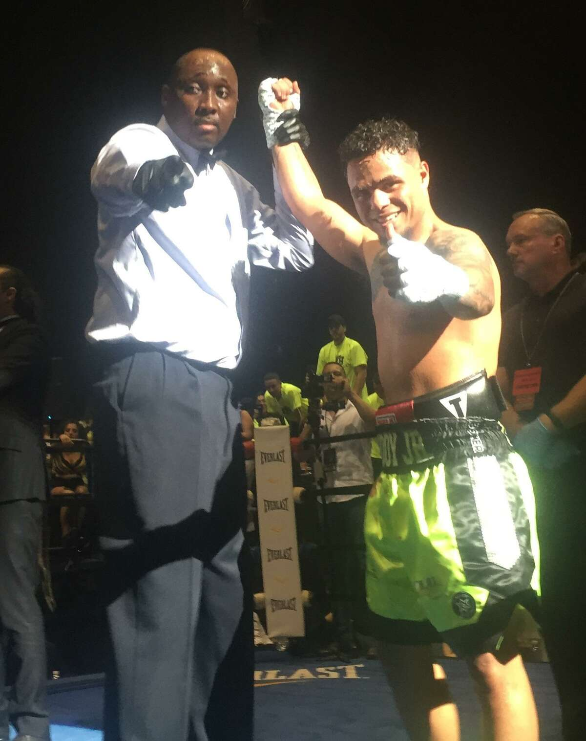 Boxer Omar Bordoy, right, is declared the winner by knockout in the sixth round of his fight against Alexander Picot at the Xfinity Theatre in Hartford on June 16, 2018.