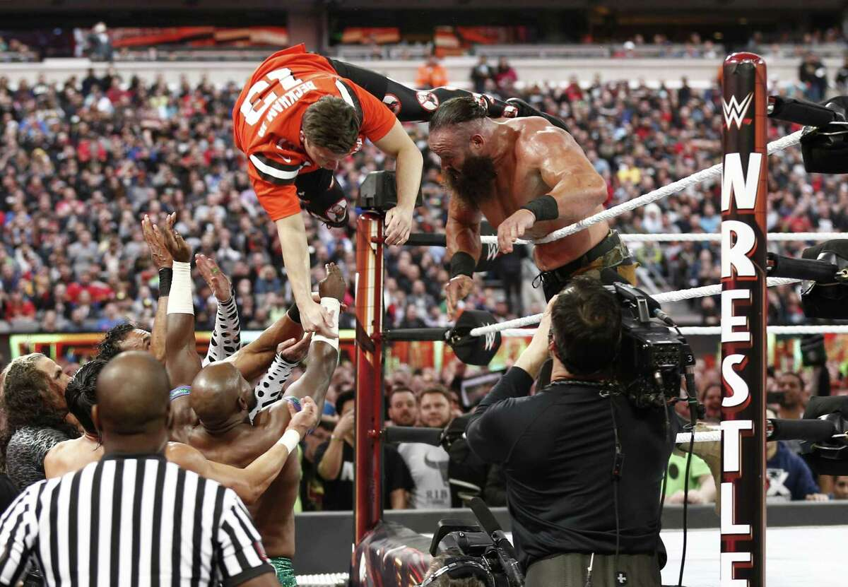 EAST RUTHERFORD, NEW JERSEY - APRIL 07: Braun Strowman tosses Colin Jost out of the ring during SNL's Michael Che and Colin Jost at WWE WrestleMania at Met Life Stadium on April 07, 2019 in East Rutherford, New Jersey. (Photo by Brian Ach/Getty Images for WWE)