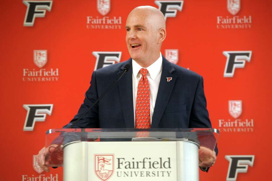 Jay Young speaks after being introduced as the new men's basketball coach at Fairfield University in April. Photo: Ned Gerard / Hearst Connecticut Media / Connecticut Post