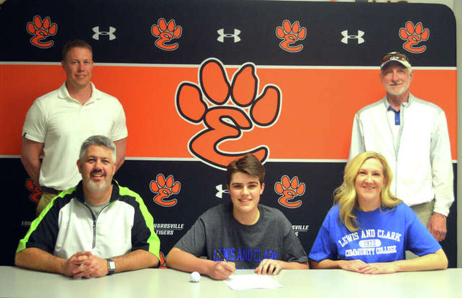 Edwardsville senior Ben Patterson, seated middle, signed to play golf at Lewis and Clark Community College in Godfrey. He is joined by his parents, EHS coach Adam Tyler and Lewis and Clark coach Gerald Mozur. Photo: Scott Marion/Intelligencer