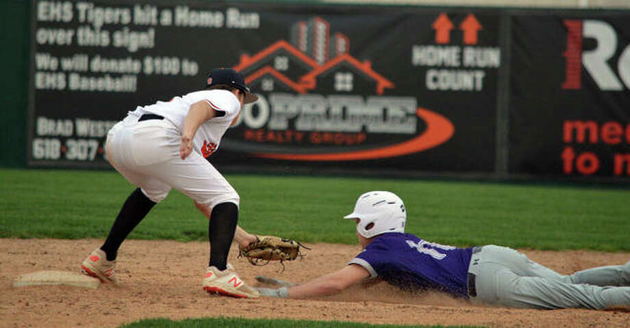Edwardsville second baseman Logan Cromer, left, tags out a Collinsville baserunner on an attempted stolen base during the sixth inning of Wednesday's Southwestern Conference game at Tom Pile Field.