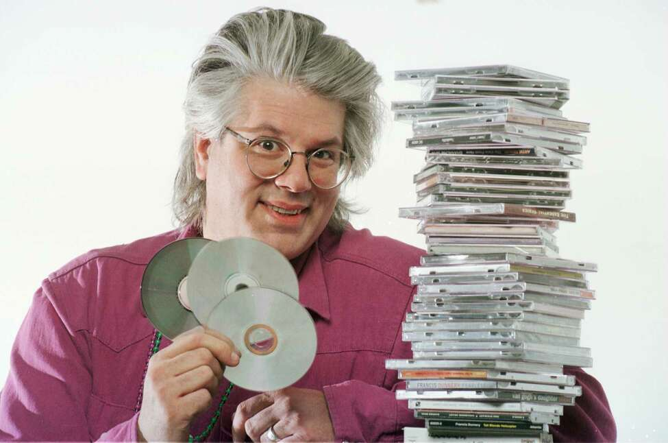 Times Union's Greg Haymes poses with CDs in Times Union studio Tuesday February 20, 1996. (TIMES UNION staff photo by John Carl D'Annibale)