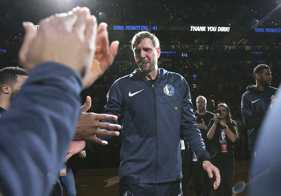 Dallas Mavericks' Dirk Nowitzki (41) appears emotional after a tribute video by the Spurs before the start of the game against the Spurs at the AT&T Center on Wednesday, Apr. 10, 2019. (Kin Man Hui/San Antonio Express-News) Photo: Kin Man Hui/Staff Photographer