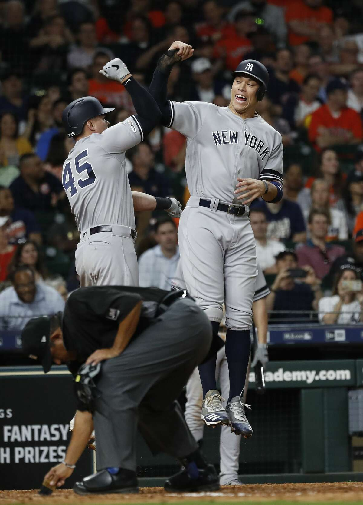 New York Yankees designated hitter Luke Voit celebrates his two-run home run with Aaron Judge (99) during the eighth inning of an MLB game at Minute Maid Park, Wednesday, April 10, 2019, in Houston.