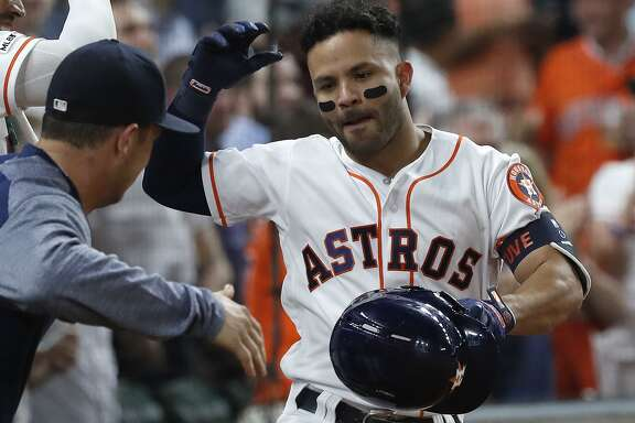 Jose Altuve, right, celebrates his second home run of Wednesday night's game, a fifth-inning solo shot, with Alex Bregman.
