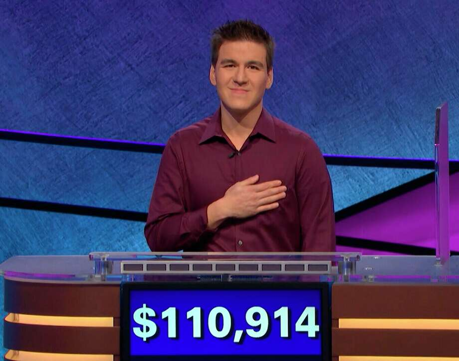 "This image made from video aired on ""Jeopardy!"" on Tuesday, April 9. 2019, and provided by Jeopardy Productions, Inc. shows James Holzhauer.  The 34-year-old professional sports gambler from Las Vegas won more than $110,000 on ""Jeopardy!"" on Tuesday, breaking the record for single-day cash winnings. (Jeopardy Productions, Inc. via AP) / Jeopardy Productions, Inc."