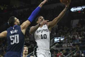 San Antonio Spurs' DeMar DeRozan goes for two against Dallas Mavericks' Salah Mejri during the first half at the AT&T Center, Wednesday, April 10, 2019.