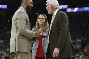 San Antonio Spurs assistant coach Becky Hammon joins assistant coach Ime Udoka and head coach Gregg Popovich during a break in the second half against the Dallas Mavericks at the AT&T Center, Wednesday, April 10, 2019. The Spurs won, 105-94.