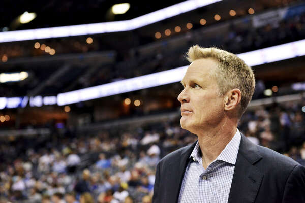 Golden State Warriors head coach Steve Kerr stands on the court before an NBA basketball game against the Memphis Grizzlies Wednesday, April 10, 2019, in Memphis, Tenn. (AP Photo/Brandon Dill)
