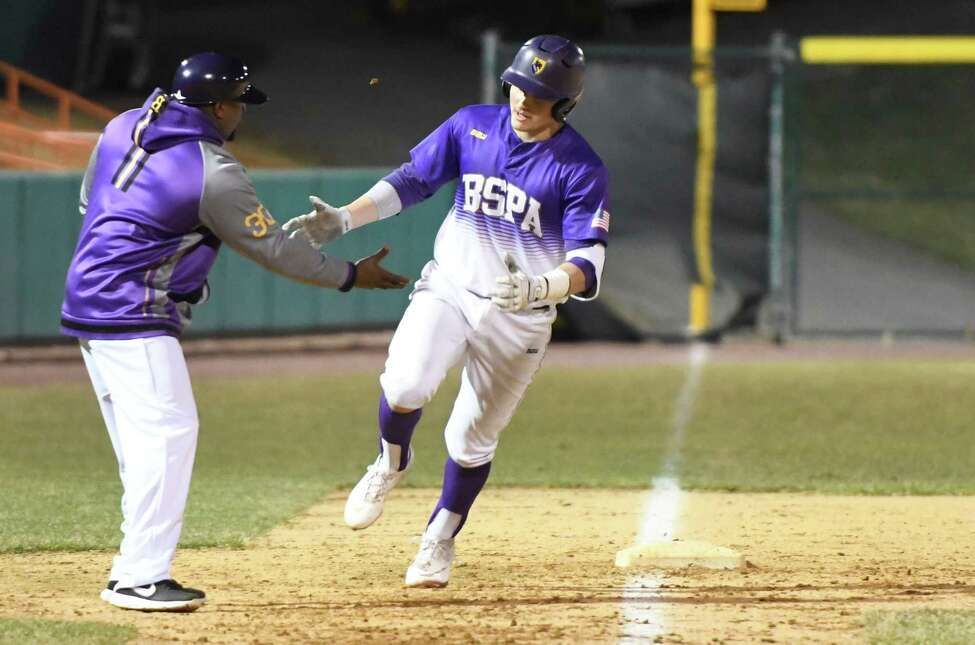 Ballston Spa's Luke Gold gets a hi-five from his coach as he crosses third after hitting a home run during a game against Shaker at Hudson Valley Community College in Troy, N.Y., on Wednesday, Apr. 10, 2019. (Jenn March, Special to the Times Union)