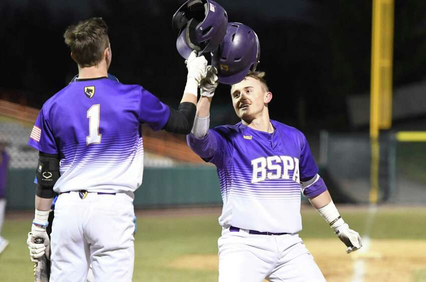 Ballston Spa's Luke Gold clinks helmets with teammates congratulating him for his home run during a game against Shaker at Hudson Valley Community College in Troy, N.Y., on Wednesday, Apr. 10, 2019. (Jenn March, Special to the Times Union)
