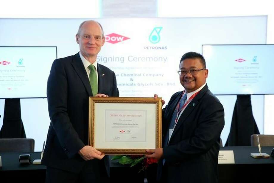 Dow presenting a Certificate of Acknowledgement to PETRONAS Chemicals Glycols for participating in the Dow-IOC carbon partnership program. (Photo provided)
