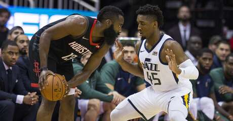 Houston Rockets guard James Harden (13) is guarded by Utah Jazz guard Donovan Mitchell (45) during the first half of an NBA basketball game between the Houston Rockets and Utah Jazz, Wednesday, Oct. 24, 2018 in Houston.