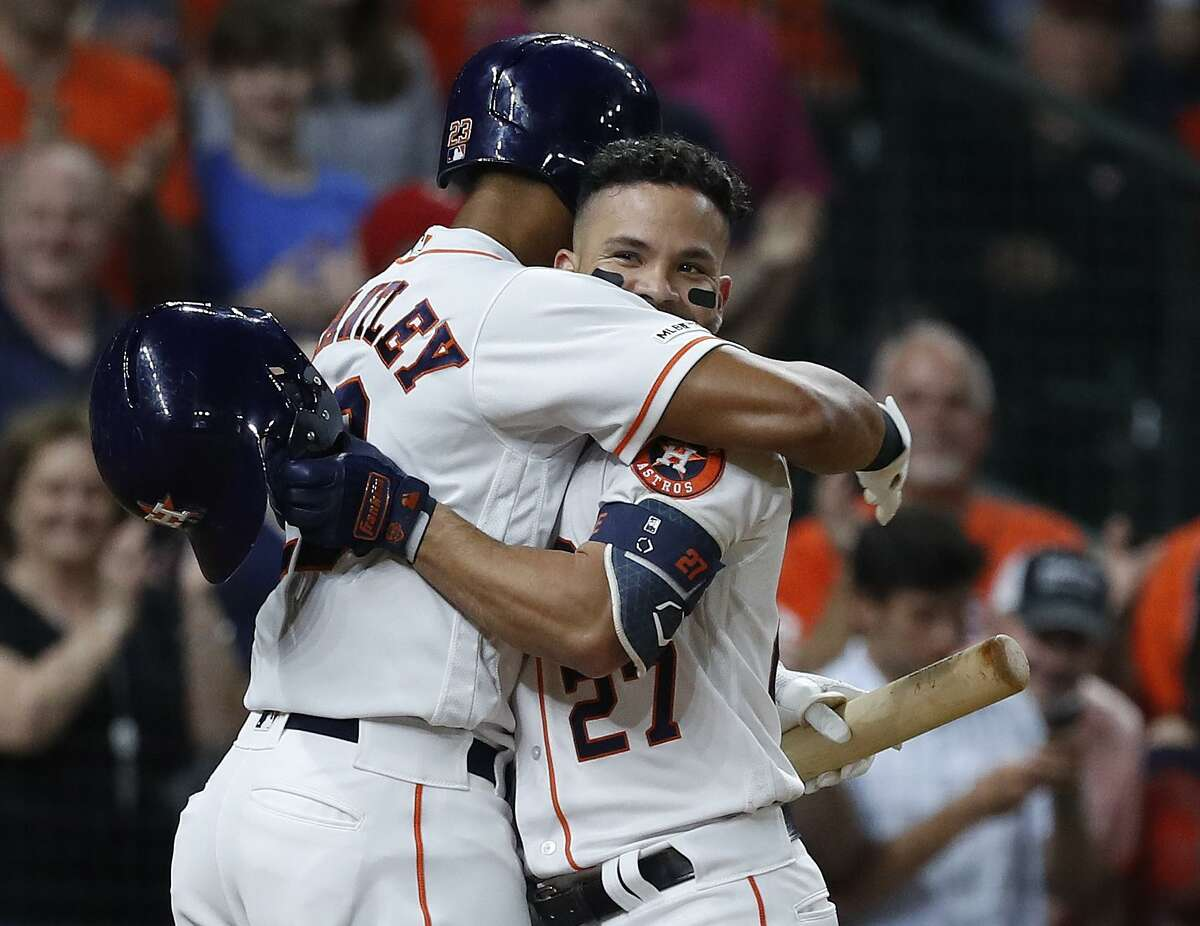 Michael Brantley, left, gives Jose Altuve a hug deserving of someone who has just homered for the second time Wednesday.