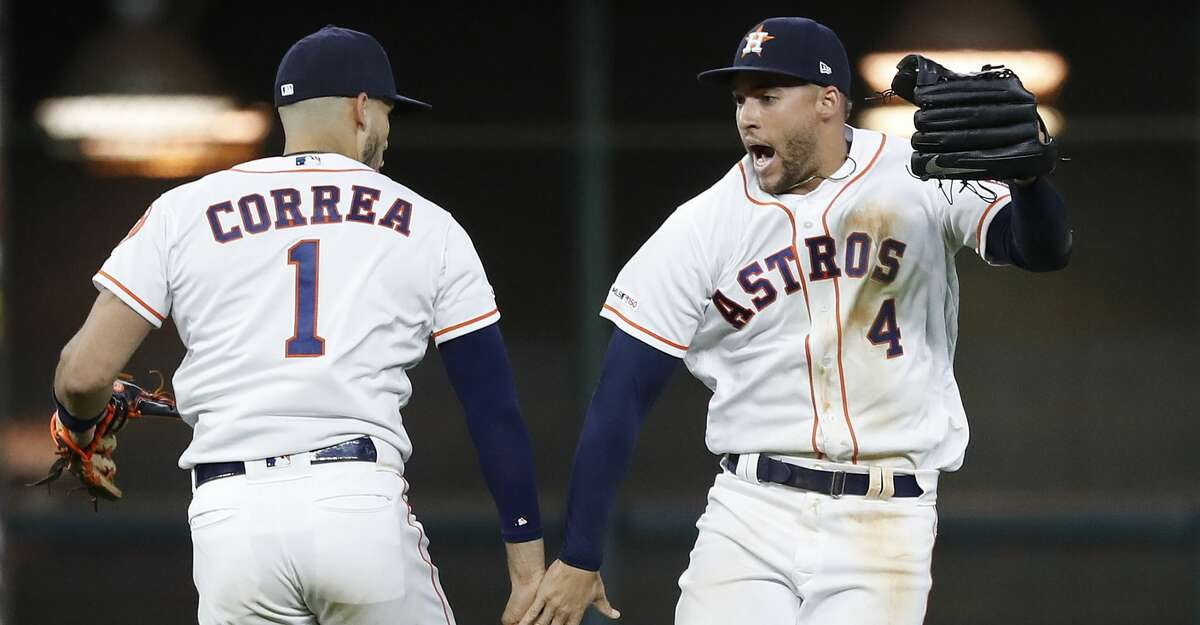 Houston Astros Carlos Correa (1) and George Springer (4) celebrate the Astros sweep of the New York Yankees after an MLB game at Minute Maid Park, Wednesday, April 10, 2019, in Houston. Astros won 8-6.