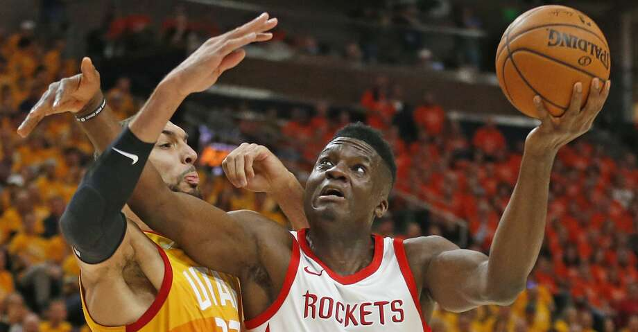PHOTOS: Rockets game-by-game In this May 4, 2018, file photo, Utah Jazz center Rudy Gobert (27) defends against Houston Rockets center Clint Capela (15) during the first half in Game 3 of an NBA basketball second-round playoff series in Salt Lake City. (AP Photo/Rick Bowmer, File) Browse through the photos to see how the Rockets fared in each game this season. Photo: Rick Bowmer/AP