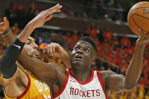 """FILE - In this May 4, 2018, file photo, Utah Jazz center Rudy Gobert (27) defends against Houston Rockets center Clint Capela (15) during the first half in Game 3 of an NBA basketball second-round playoff series in Salt Lake City. The league is taking notice that Capela is one of the pivotal pieces to Houston's success as the team prepares for its showdown with Golden State in the Western Conference finals starting Monday. """"What he does is as good or better than anybody in the league without a doubt,"""" coach Mike D'Antoni said. (AP Photo/Rick Bowmer, File)"""