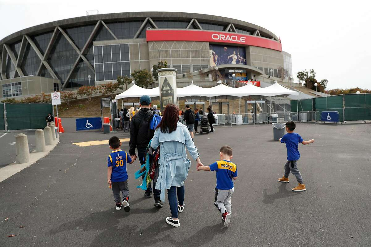 Golden State Warriors' fans arrive for Warriors' game against Detroit Pistons at Oracle Arena in Oakland, Calif., on Sunday, March 24, 2019.