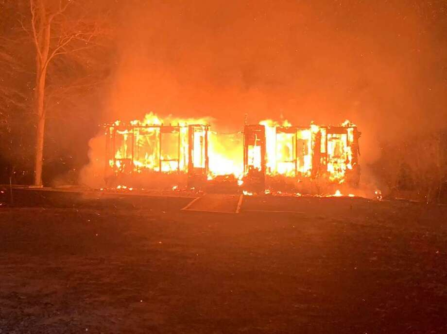 Firefighters from nearly a dozen nearby departments helped the East Haddam Fire Department put out a roaring blaze at an unoccupied residence on Honey Hill Road onWednesday, April 10, 2019 Photo: East Haddam Fire Department Photo