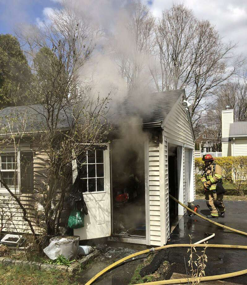 Firefighters quickly knocked down a garage fire on Wednesday, April 10, 2019 on Shadow Ridge Road. The fire was extinguished quickly by firefighters and contained to the garage. There was no damage to adjacent homes. Photo: Stamford Fire Department Photo