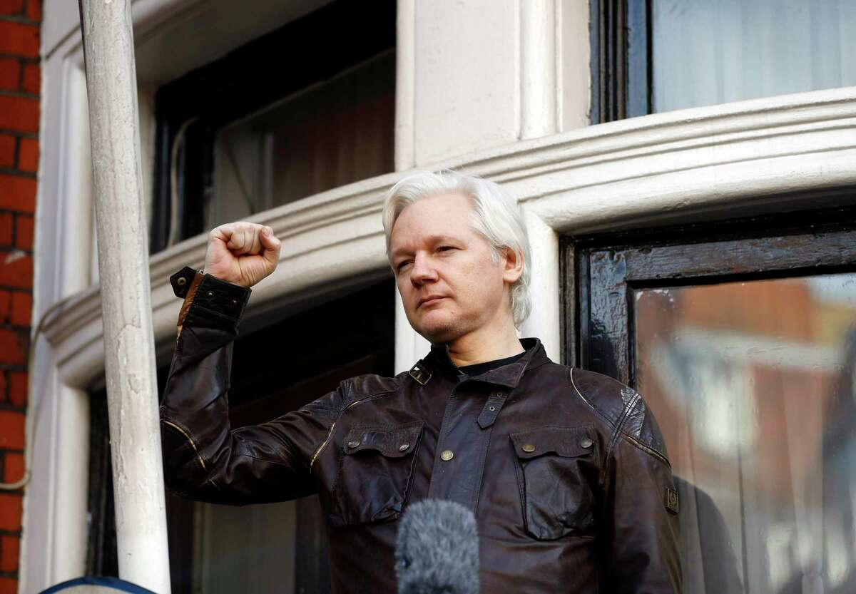 FILE - In this Friday, May 19, 2017 file photo, Julian Assange greets supporters outside the Ecuadorian embassy in London. London police say they've arrested WikiLeaks founder Julian Assange at the Ecuadorian embassy, it was reported on Thursday, April 11, 2019.