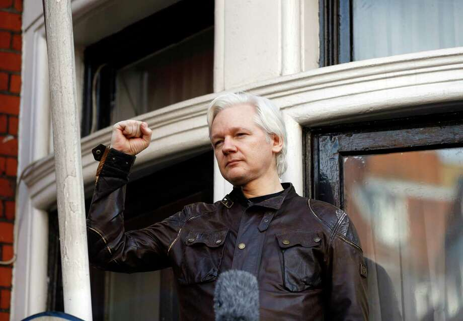 FILE - In this Friday, May 19, 2017 file photo, Julian Assange greets supporters outside the Ecuadorian embassy in London. London police say they've arrested WikiLeaks founder Julian Assange at the Ecuadorian embassy, it was reported on Thursday, April 11, 2019. Photo: Frank Augstein, AP / Copyright 2017 The Associated Press. All rights reserved.