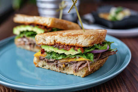 Shaved beef and avocado sandwich is among the new menu items at FM Kitchen & Bar, 1112 Shepherd.
