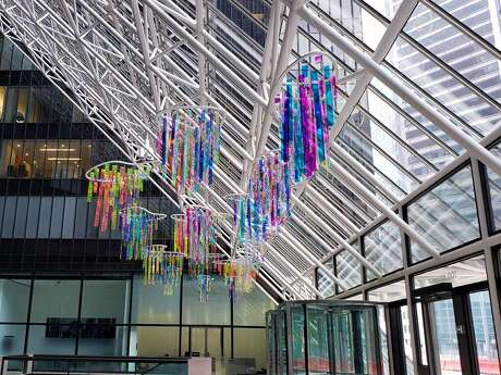 Holographic Sky hangs from the top of the atrium at Pennzoil Place in downtown Houston.