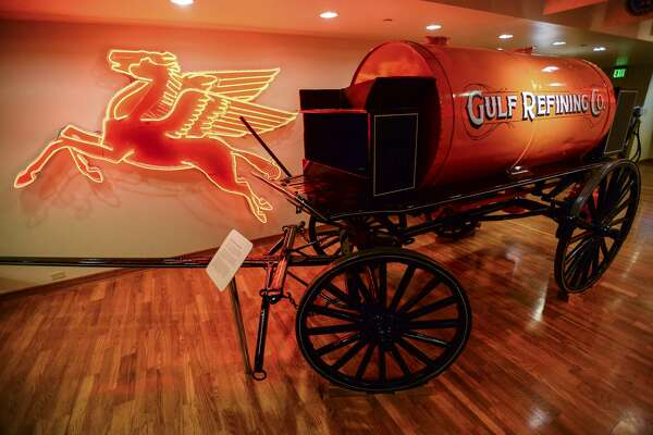 Shown here is a Mobil porcelain pegasus sign and a Gulf tank delivery wagon on the second floor of the Texas Energy Museum. Mobil's presence in Beaumont goes back to 1918 when the company acquired a majority interest in Magnolia Petroleum Company. The tank delivery wagon was used to carry kerosene from 1910 until 1926 and could carry 500 gallons at a time. The driver filled small cans from the tank and carried them to retail stores where they were sold to customers by the half or whole gallon. Photo taken on Tuesday, 03/05/19. Ryan Welch/The Enterprise