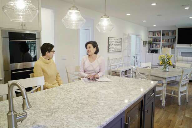 Homeowner, Deanna Hedges, left, talks with her real estate agent, Fran Callahan, with Berkshire Hathaway HomeServices Blake, on Monday, March 18, 2019, in Loudonville, N.Y. (Paul Buckowski/Times Union)
