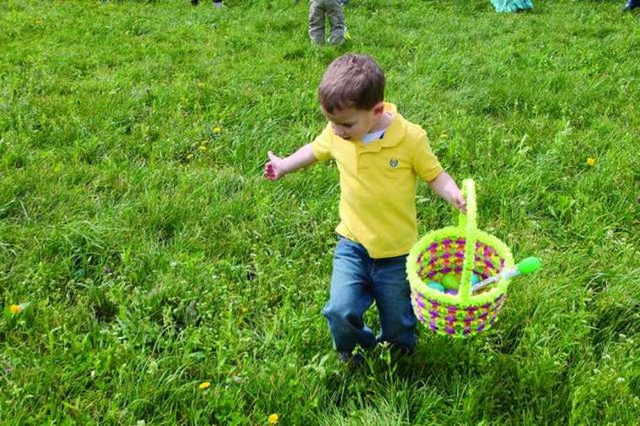 A youngster searches for hidden treasures at a previous Easter egg hunt in Edwardsville. Photo: Intelligencer File Photo