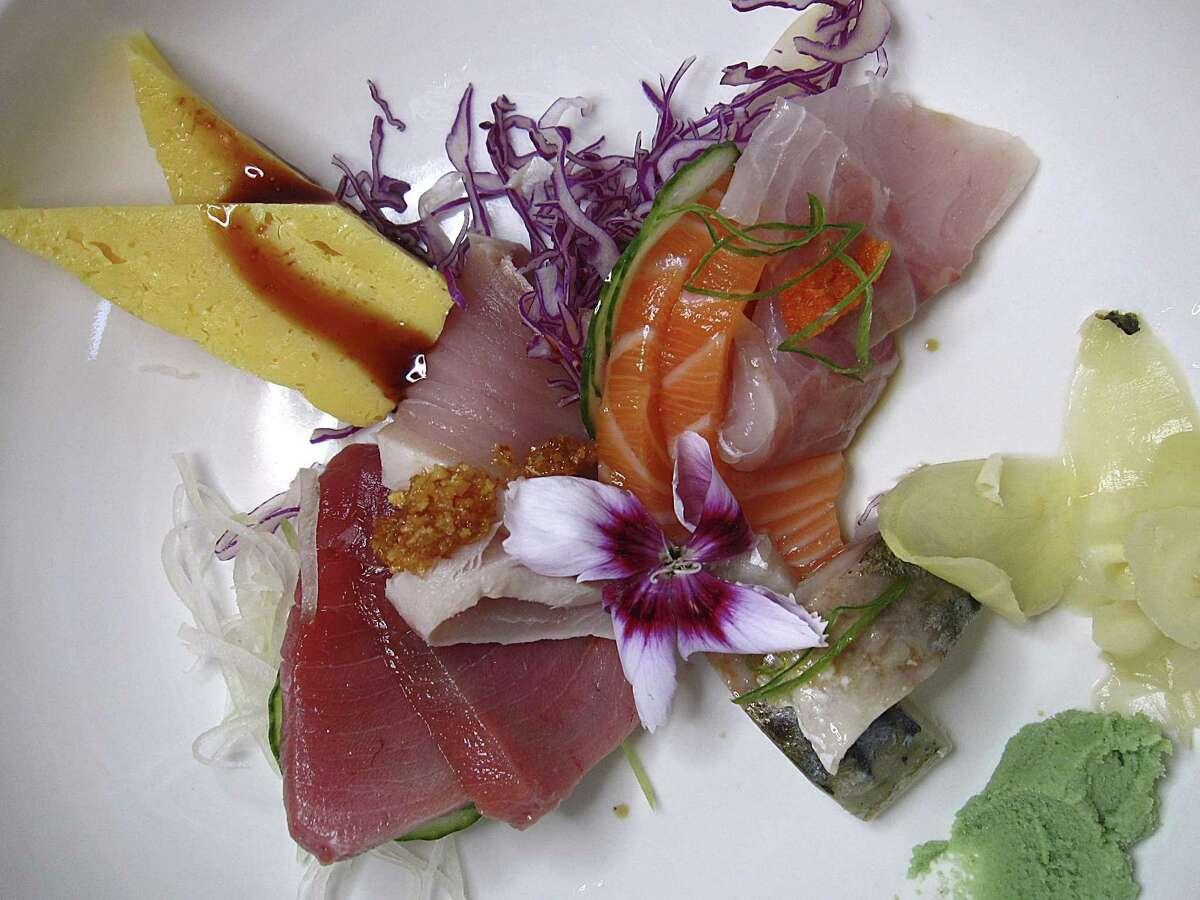 A lunchtime sashimi appetizer includes yellowtail, tamago, seared albacore tuna, salmon and mackerel at Sushihana.