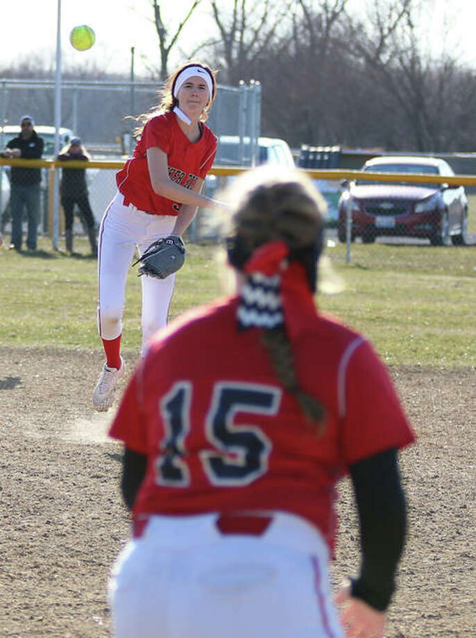Bunker Hill shortstop Brylie Chrisman throws to first baseman Sydney Gresham (15) for an out in a game earlier this season in Bunker Hill. The Minutemaids were back at home Wednesday and earned their first win by beating Roxana. Photo: Greg Shashack / The Telegraph