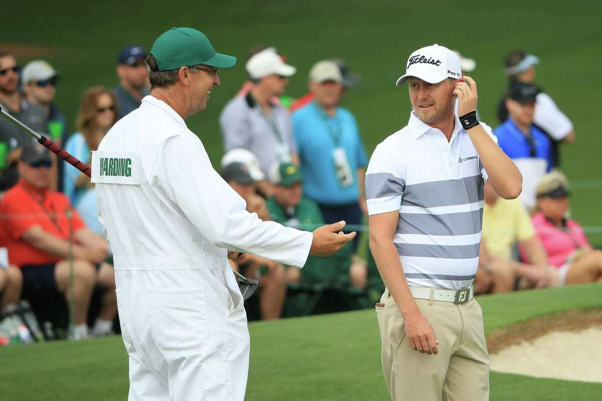 AUGUSTA, GEORGIA - APRIL 11: Justin Harding of South Africa talks with caddie Alan Burns on the second green during the first round of the Masters at Augusta National Golf Club on April 11, 2019 in Augusta, Georgia.