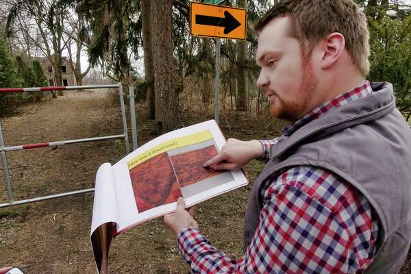 Billy Burns shows a photo of a map from 1851 that shows the Shaker farm that he is standing near on Sunday, April 7, 2019, in Loudonville, N.Y.   (Paul Buckowski/Times Union)