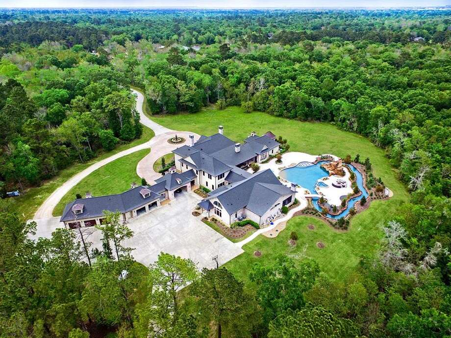 This recently listed $2.5 million Crosby ranch comes equipped with its own mini water park and lazy river in the backyard. The 11,801 square-foot estate sits on 49 acres and consists of nine bedrooms, eight full and six half bathrooms, chef's kitchen, game room, personal gym, an enclosed loggia and even a pet grooming room. Photo: TK Images/Houston Association Of Realtors