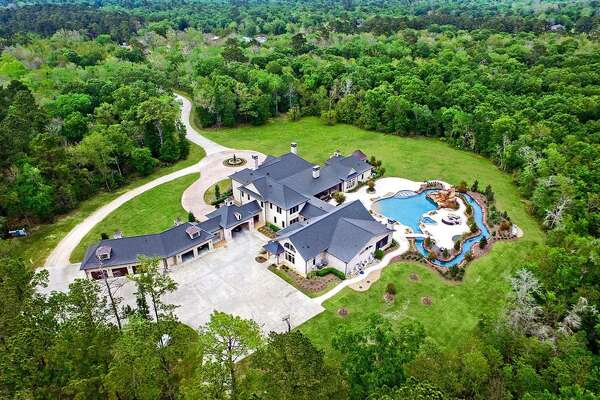 This recently listed $2.5 million Crosby ranch comes equipped with it's own mini water park and lazy river in the backyard. The 11,801 square-foot estate sits on 49 acres and consists of nine bedrooms, eight full and six half bathrooms, chef's kitchen, game room, personal gym, an enclosed loggia and even a pet grooming room.
