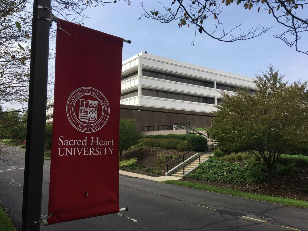 This Oct. 2, 2018, photo shows the former General Electric headquarters in Fairfield, Conn., that was purchased by Sacred Heart University in 2016. Office parks sitting vacant on the edges of cities around the U.S. have repurposed as schools by a number of urban and suburban districts due to growing enrollment, a scarcity of available land and evolving ideas about the elements required for a school building. (AP Photo/Mike Melia)