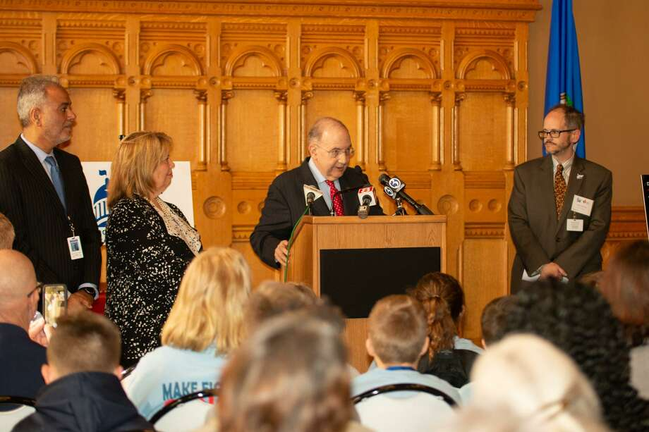 Senate President Martin Looney, center, speaks Wednesday in the State Capitol on legislation aiming to raise the age of access to tobacco products as Sens. Saud Anwar, left, and Mary Abrams, D-Meriden, look on. Photo: Contributed Photo