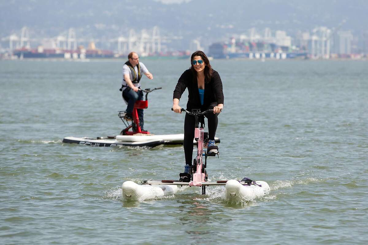 Jessica Schiller and Matthew Shambroom pedal their electric-assisted water bikes during a demonstration of the bikes at McCovey Cove in San Francisco, Calif. on Sunday, April 7, 2019.