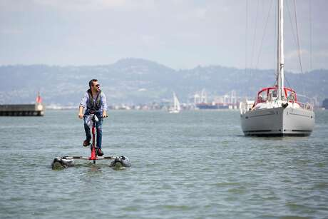 Richard Pulliam pedals his electric-assisted water bike. Photo: Brittany Hosea-Small / Special To The Chronicle