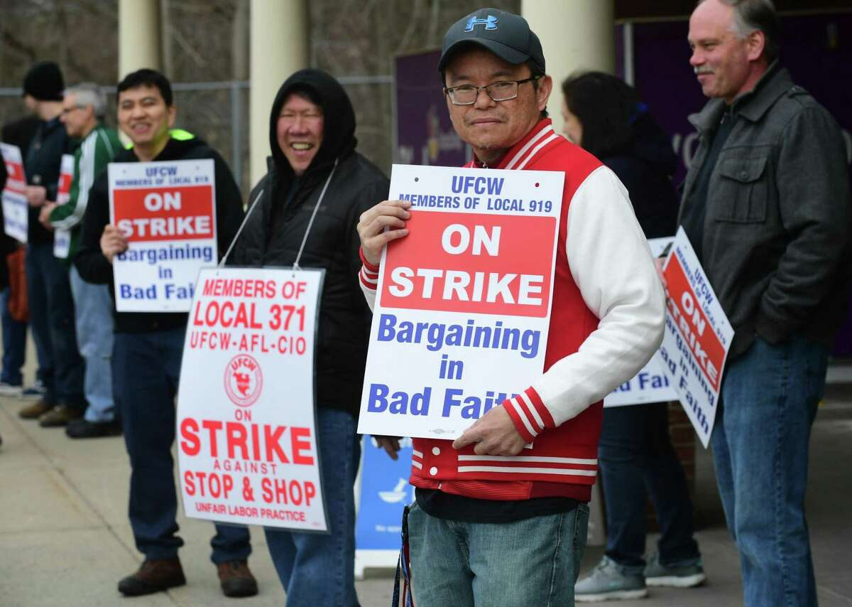 Workers with the UFCW-AFL-CIO Local 371 strike Thursday at the Stop & Shop on Main Avenue in Norwalk.