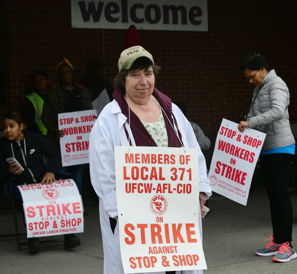 Workers with the UFCW-AFL-CIO Local 371 including Jean Federici strike Thursday, April 11, 2019, at the Stop & Shop on Main Avenue in Norwalk, Conn.